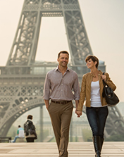 couple by eiffel tower